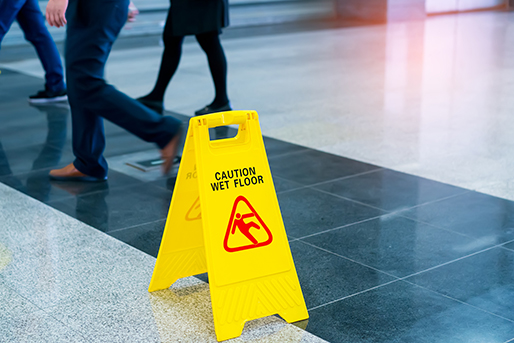 Caution wet floor sign in an office building